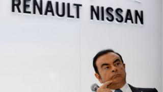 CEO of Renault-Nissan Carlos Ghosn listens while attending a joint press conference along with CEO of German automaker Daimler Dieter Zetsche at the Paris Motor Show on September 30, 2016.