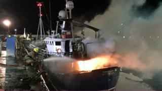 Boat on fire in Peterhead harbour