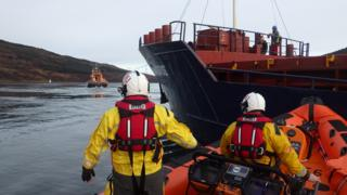 Mallaig and Kyle lifeboats holding vessel in position until tug arrives