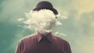 Surreal photomontage: a man with a bowler hat, and a cloud over his head