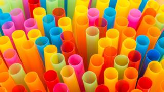 A collection of colourful drinking straws