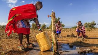 A woman from the Maasai tribe collects water in Kenya