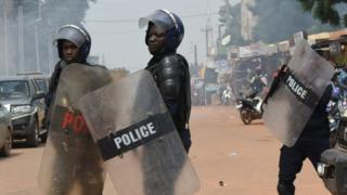 Riot police officers disperse a march called by the UAS union asking for better security measures against terrorism, on September 16, 2019 in Ouagadougou.