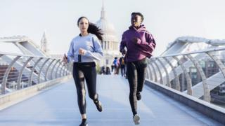 Women jogging with St Paul's in the background