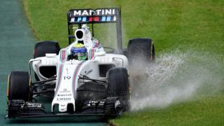 Williams driver Felipe Massa of Brazil steers his car through surface water off the track during the first practice session at the Australian Formula One Grand Prix at Albert Park in Melbourne, Australia