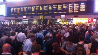 Passengers waiting at Euston station