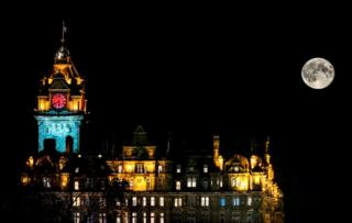 Balmoral clock in Edinburgh lit up red for Poppyscotland