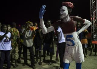 A supporter of New Patriotic Party with number 5 painted on his body referring to the position occupied by the party on the electoral roll for the Ghana National Elections on December 7, takes part in a prayer vigil in Koforidua on November 16, 2016.