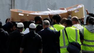 Body of a victim of the mosque attacks arrives during the burial ceremony at the Memorial Park Cemetery in Christchurch, New Zealand March 20, 2019