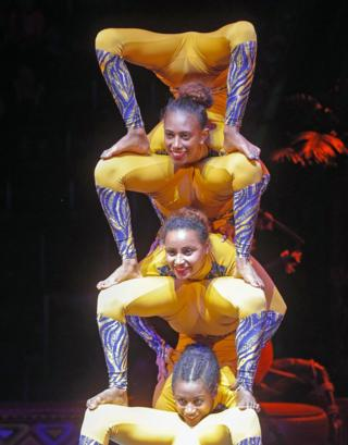Female Ethiopian acrobats in a tower on one another performing in Kiev, Ukraine - Saturday 8 February 2020