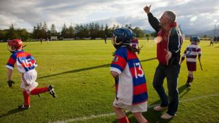 Children playing shinty in Kingussie