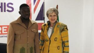 Emmanuel Okoro and Theresa May
