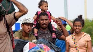 People cross the Simon Bolivar International Bridge on the border between the Colombian city of Cucuta and the Venezuelan Tachira, on February 5, 2019