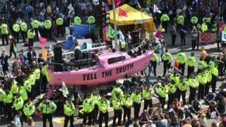 Officers surround the pink boat at Oxford Circus