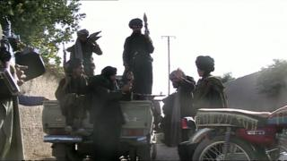 File photo of Taliban fighters in Afghanistan in November 2009