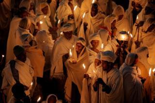 Ethiopian Orthodox pilgrims attend Christmas Eve celebration.