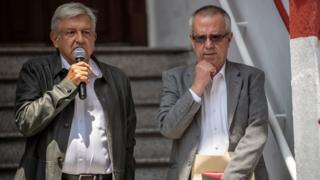 Mexico's President-elect Andres Manuel Lopez Obrador (L) speaks during a press conference next to his appointed Finance Minister Carlos Urzua, at their party's headquarters in Mexico City on July 23, 2018.
