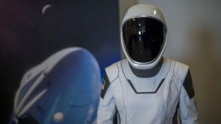 A spacesuit designed for use on the Crew Dragon spacecraft is seen during a media tour of SpaceX headquarters and rocket factory on August 13, 2018 in Hawthorne, California.