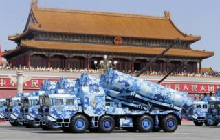 Military vehicles carrying shore-to-ship missiles drive past the Tiananmen Gate during a military parade to mark the 70th anniversary of the end of World War Two, in Beijing, China, 3 September 2015