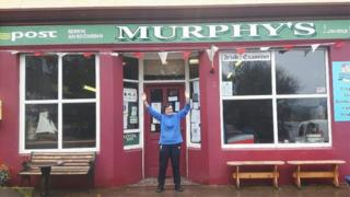 Mary Murphy outside her post office on Bere Island