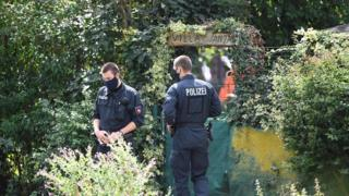 sports Police works at the site where they started digging in an allotment area near Hanover, Germany July 29, 2020
