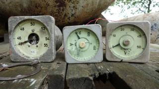 Three diving pressure gauges