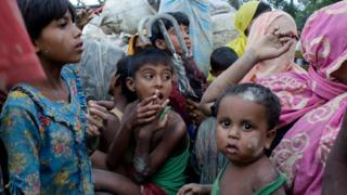 Rohingya refugees wait inside a truck as they arrive at the Bangladesh border at Teknaf, Bangladesh, 9 September 2017