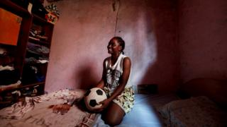 Ida Daniela Pouadjeu with her football