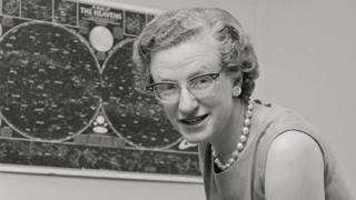 Dr. Nancy Grace Roman, chief of astronomy for NASA, is shown in her office