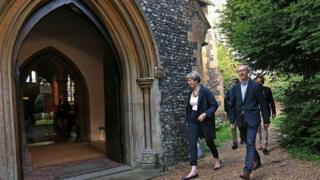 Theresa May and her husband Philip attending a church service in her constituency