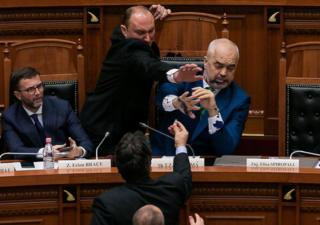 Albania's Prime Minister Edi Rama reacts as ink is thrown at him by members of the opposition during a parliamentary session in Tirana, Albania, 14 February 2019.