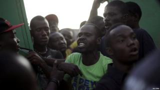 People argue at a voting station in Haiti