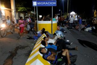 Honduran migrants rest at the checkpoint between Guatemala and Mexico, in Tecun Uman, Guatemala