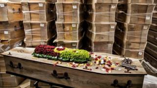 A picture taken in a funeral house in Johannesburg, on July 26, 2020 shows coffins stacked at the warehouse. - South Africa has the highest numbers of diagnosed infections in Africa and ranks fifth in the world after the United States, Brazil, India and Russia.