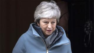Theresa May leaves 10 Downing Street on 26 March