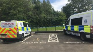 Police vans in Livingston
