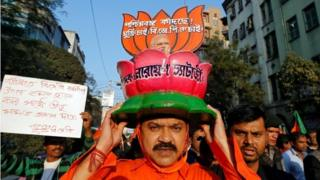 A Bharatiya Janata Party (BJP) supporter wears a hat with the party's symbol lotus in Kolkata on 30 January 2019