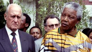 South African President Nelson Mandela speaks next to Fifa President Joao Havelange (L) in South Africa - 12 January 1996