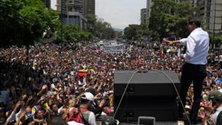Juan Guaido attends a rally in Venezuela