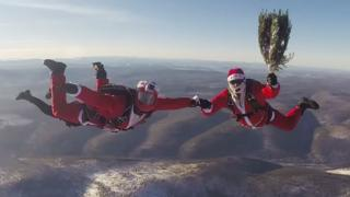 Father Christmases skydiving over Siberia December 2016