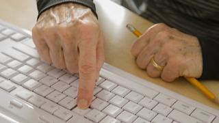 Pensioner using computer