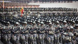 Rows and rows of North Korean soldiers, stretching as far as the eye can see, march in full tactical gear