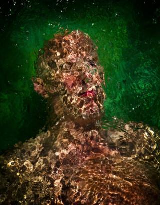 Portrait of a man underwater