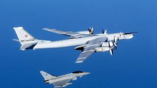 Russian Bear aircraft escorted by a Royal Air Force Quick Reaction Alert Typhoon in September 2014