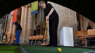 Reverend Rachel Phillips plays golf
