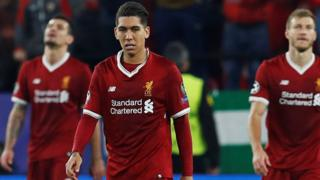 Liverpool's players react after conceding against Sevilla in the Champions League