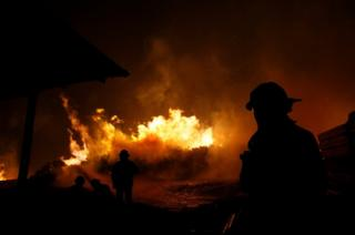 Firefighters try to stop the fire