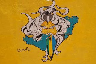 A mural of a man with a beard in the colours of Sudan's old flag - Khartoum, Sudan