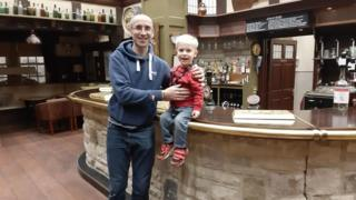 Emmerdale star James Hooton, who plays Sam Dingle, with Archie