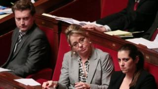 French MPs (from left) David Comet, Anne-Christine Lang, and Julie Sommaruga attend a debate at the French National Assembly in Paris (09 February 2016)